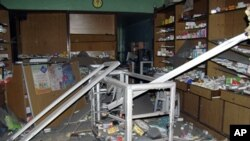 A damaged pharmacy is seen in the Bab Sabaa neighborhood of Homs October 10, 201