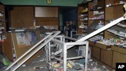 A damaged pharmacy is seen in the Bab Sabaa neighborhood of Homs October 10, 201
