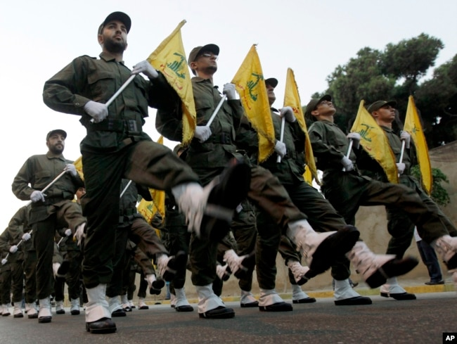 FILE - Hezbollah fighters march in a parade at the southern suburb of Beirut, Lebanon, Nov. 12, 2010.