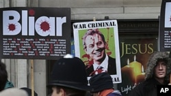 Protesters demonstrate against former British Prime Minister Tony Blair outside the venue where the Iraq inquiry is being held, in central London, 21 Jan 2011