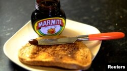 Whether you eat your toast with jam, peanut butter or Marmite, just don't burn it, say U.K. health officials. (Photo taken in Manchester, Britain in 2016 by Phil Noble for REUTERS.)
