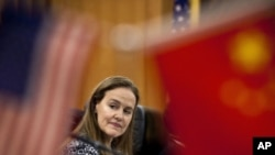 U.S. Defense Undersecretary Michele Flournoy, prepares for a bilateral meeting with Gen. Ma Xiaotian, the People's Liberation Army's deputy chief of staff, at the Bayi Building in Beijing, China, December 7, 2011.