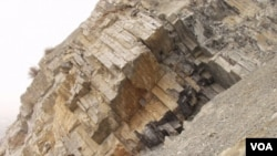 """FILE - Limestone layers in between volcanic ash beds from Meishan, China, during the """"Great Die-Off"""" (Courtesy: Shuzhong Shen)."""