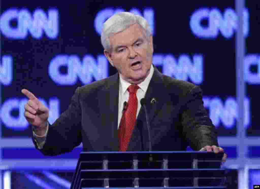 Republican presidential candidate former House Speaker Newt Gingrich reacts to a question at the start of the Republican presidential candidate debate at the North Charleston Coliseum in Charleston, S.C., Thursday, Jan. 19, 2012. Gingrich is denying that