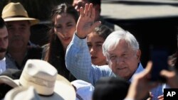 Mexican President Andres Manuel Lopez Obrador waves as he arrives for a meeting with dairy farmers in La Chona de Encarnacion de Diaz, Jalisco, Mexico, March 9, 2019.