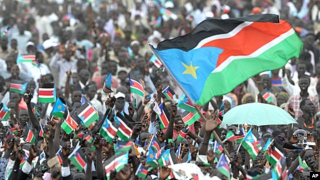 Thousands of Southern Sudanese wave the flag of their new country during a ceremony in the capital Juba on July 09, 2011 to celebrate South Sudan's independence from Sudan