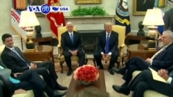 VOA60 America - President Donald Trump met with opposition Democrats