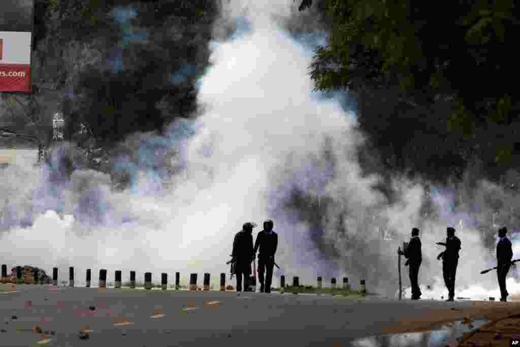 Kenyan police use tear gas to disperse Nairobi University Students, who rioted over the death of two of their colleagues, in Nairobi. The students said they wanted an explanation of how the two engineering students died within a day while in police custody.