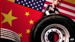 중국 자동차 업체인 포톤의 제조공장에서 남성이 타이어를 옮기고 있다.