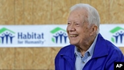 Former president Jimmy Carter is seen being interviewed at a Habitat for Humanity project site in Memphis, Tennessee, Nov. 1, 2015.