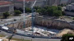 This photo taken June 2, 2013 shows the Smithsonian National Museum of African-American History and Culture being built in Washington, DC. (AP Photo/Alex Brandon)