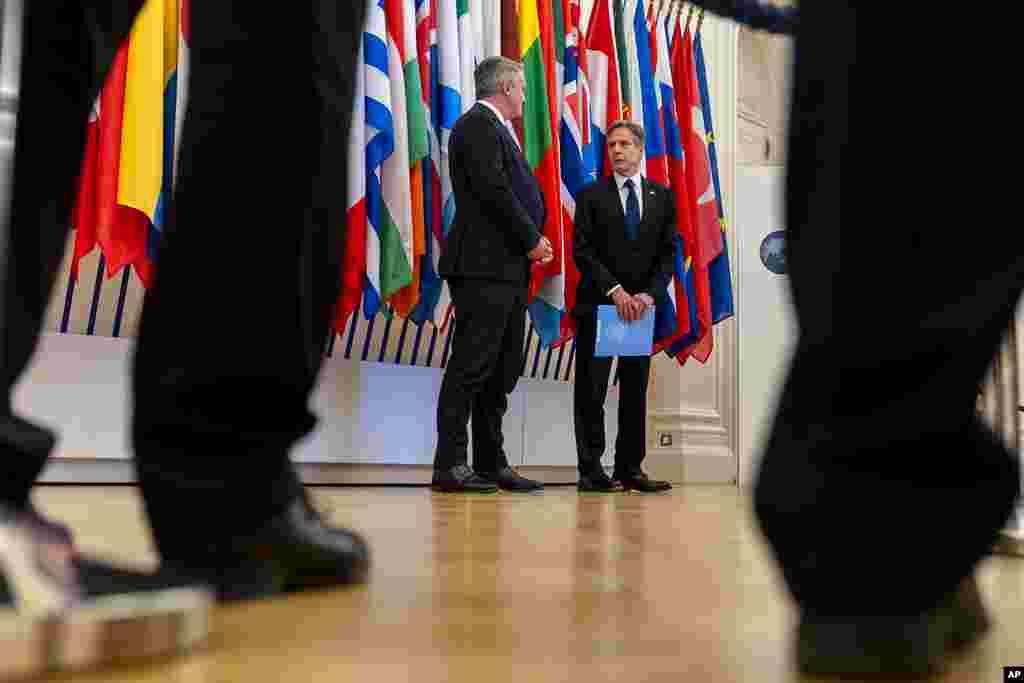 U.S. Secretary of State Antony Blinken, right, accompanied by Secretary-General of the Organization for Economic Cooperation and Development (OECD) Mathias Cormann, of Australia, speaks at the OECD headquarters in Paris.