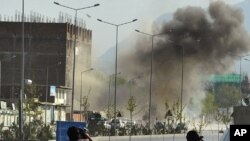 Smoke rises from the site of an attack near the Afghan parliament in Kabul April 15, 2012.