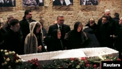 Mourners, including Dina Eidman (front row, third from left), mother of Russian leading opposition figure Boris Nemtsov, and Mikhail Kasyanov (center, rear), an opposition leader and former Russian prime minister, attend a memorial service before the fune