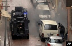 Security forces fire during an operation against two attackers, in Istanbul, March 3, 2016.