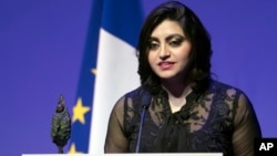 Pakistan's Gulalai Ismail delivers an acceptance speech after being awarded the Prize for Conflict Prevention for the work of her organization Aware Girls promoting women's issues and equality in Pakistan, during the award ceremony of the Jacques Chirac Foundation in Paris, Nov. 24 2016.