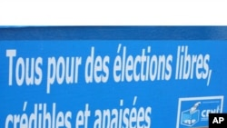 Bumper sticker issued by the DR Congo's Board of Elections.(November 2011)