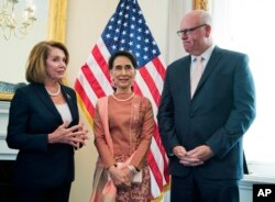 FILE - Myanmar leader Aung San Suu Kyi, center, meets House Minority Leader Nancy Pelosi of Calif.. and Rep. Joseph Crowley, D-N.Y., on Capitol Hill in Washington, Sept. 15, 2016.