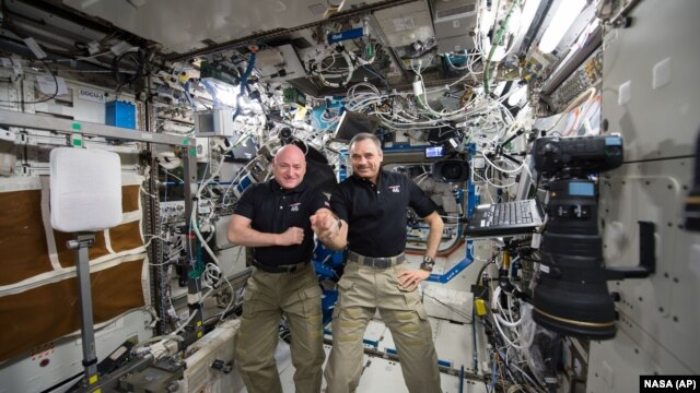 FILE - One-year mission crew members Scott Kelly of NASA, left, and Mikhail Kornienko of Roscosmos their 300th consecutive day in space, Jan. 21, 2016. The pair headed for home March 1 after spending a total of 340 days in space.