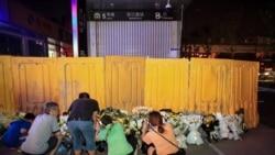 鄭州地鐵死難者頭七的悲哀:家人送花悼念親人遇擋板