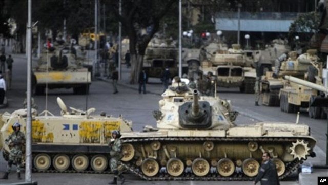 Military vehicles blocking a street in Cairo, January 30, 2011
