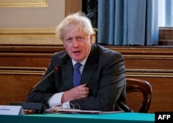 Britain's Prime Minister Boris Johnson speaks at the weekly cabinet meeting at the Foreign and Commonwealth office on September 15, 2020 in London. (Photo by Jonathan Buckmaster / POOL / AFP)