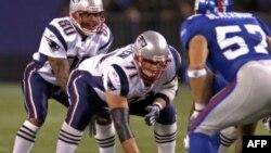 Игроки New York Giants и New England Patriots