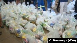 Volunteers in Harare arrange donated items destined for places affected by Cyclone Idai in Zimbabwe, March 19, 2019.