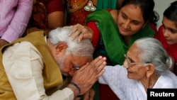 Sometimes, even world leaders have to get permission from the mothers. Here, Hindu nationalist Narendra Modi, India's new prime minister, seeks blessings from his mother.