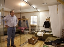 Steve Leger, executive director of the Heart Mountain Interpretive Learning Center, stands in a replica of a lived-in barracks room.