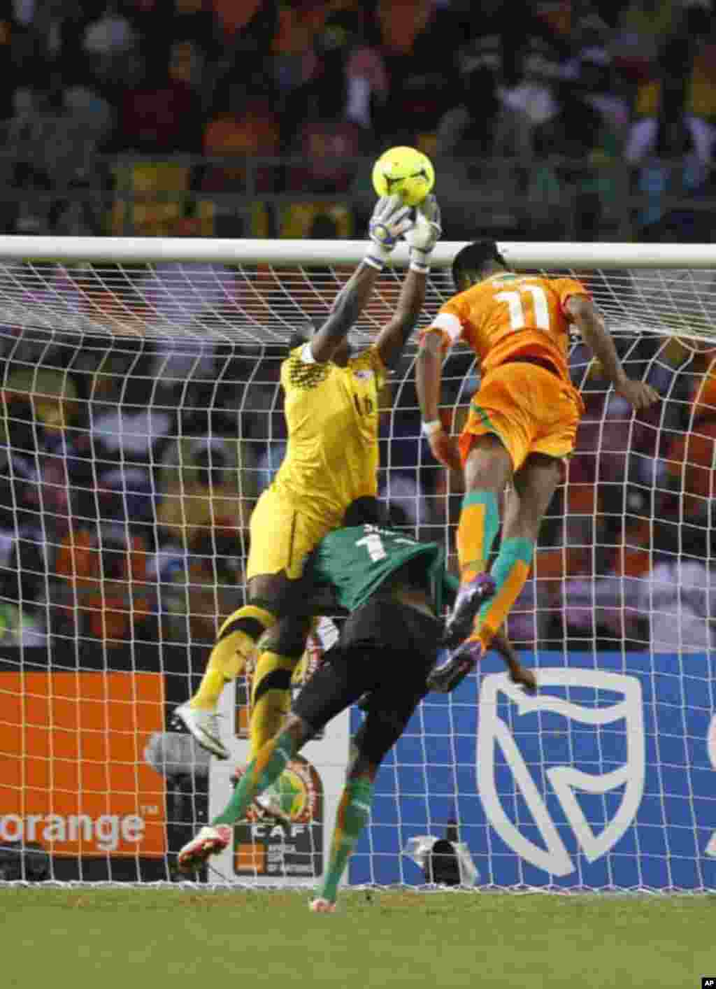 Zambia's goalkeeper Kennedy Mweene makes a save against Ivory Coast's Didier Drogba during their African Nations Cup final soccer match at the Stade De L'Amitie Stadium in Gabon's capital Libreville February 12, 2012.