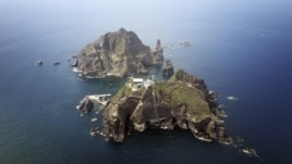 A set of remote islands called Dokdo in Korean and Takeshima in Japanese is seen in this picture taken from a helicopter, Aug. 10, 2012.