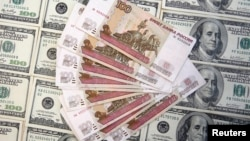 A picture illustration shows U.S. dollar and Russian ruble banknotes in Sarajevo, March 9, 2015.