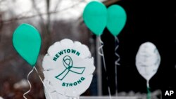 FILE - Balloons are displayed outside a doctor's office on the first anniversary of the Sandy Hook massacre, in Newtown, Connecticut, Dec. 14, 2013.