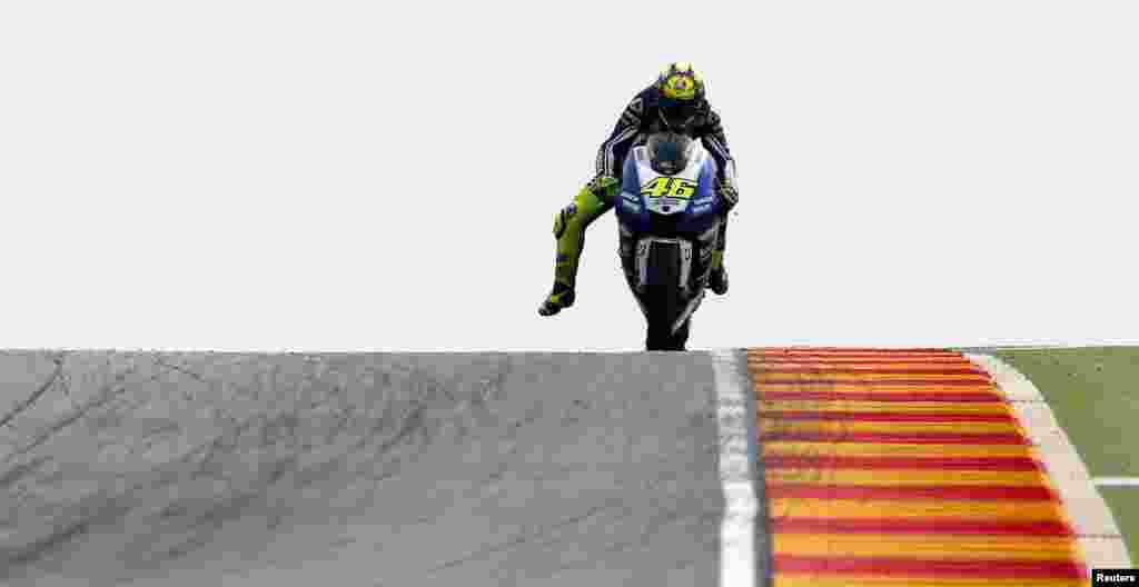 Yamaha MotoGP rider Valentino Rossi of Italy rides during the first free practice at Motorland race track in Alcaniz, Spain . The Aragon Motorcycling Grand Prix will take place on Sept. 29.