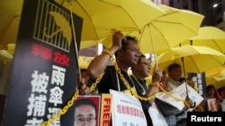 FILE - Pro-democracy protesters demanding the release of mainland activists take part in a rally in Hong Kong, China.