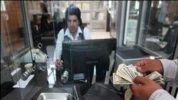 کاهش ارزش ريال در مقابل دلار آمريکا