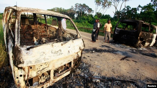 FILE - Wreckages of burnt cars are seen along the main road to Lamu from Mpeketoni after unidentified gunmen attacked the coastal Kenyan town of Mpeketoni, June 16, 2014.