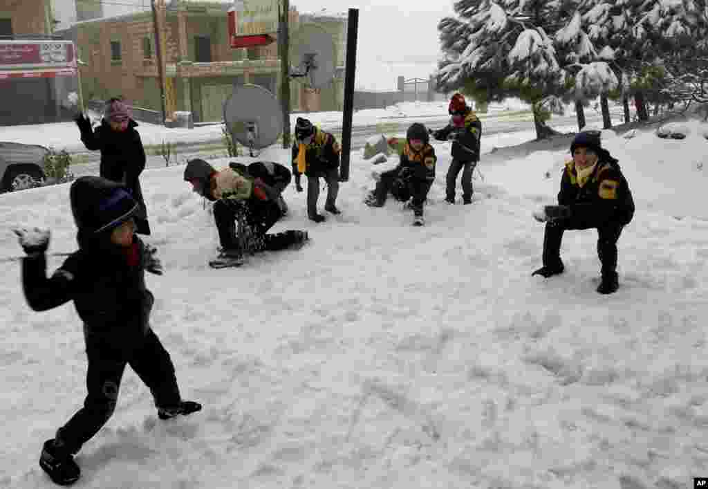 Syrian refugee children have a snowball fight at the mountain town of Bhamdoun, east of Beirut, Lebanon, January 9, 2013.