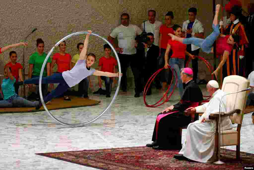 Artists perform in front of Pope Francis during a Jubilee audience for the circus performers and street artists in Paul VI Hall at the Vatican.