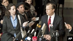U.S. Special Representative for North Korean Affairs Glyn Davies, right, speaks to journalists at a hotel after returning from talks with North Korean counterpart in Beijing Thursday, Feb. 23, 2012.