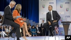 President Barack Obama participates in a town hall hosted by Univision and Univision news anchors Jorge Ramos (L) and Maria Elena Salinas (C), at the University of Miami, Florida, September 20, 2012.