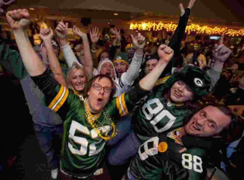 Los fans de Green Bay celebran la victoria del campeonato Super Bowl por 31-25.