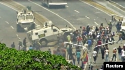A Venezuelan National Guard (GNB) vehicle ploughs into opposition demonstrators in Caracas, Venezuela in this still image taken from a video footage Apr. 30, 2019.