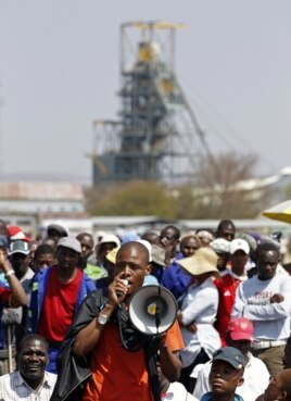 A mineworker addresses his colleagues before taking part in a march outside the Anglo American mine in South Africa's North West Province, September 12, 2012.