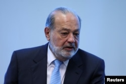 FILE - Mexican billionaire Carlos Slim speaks during a news conference in Mexico City, Mexico.