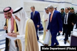 U.S. Secretary of State John Kerry walks with United Kingdom Under Secretary of Foreign Affairs Tobias Ellwood and United Arab Emirates Foreign Minister Abdullah bin Zayed on August 25, 2016, in the Royal Terminal 1 at King Abdulaziz International Airport.