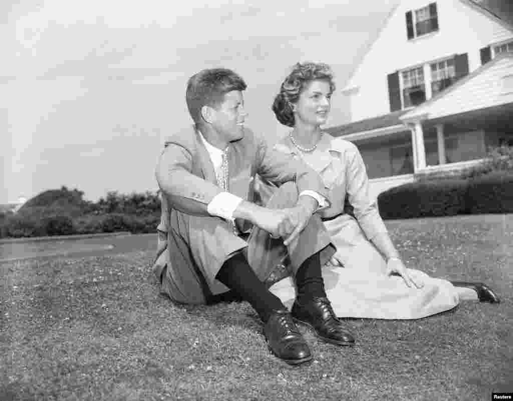 Sen. John F. Kennedy, D-Mass., and his fiancee Jacqueline Bouvier, 23, pose on the lawn of the Kennedy residence during their weekend visit at Hyannis, Ma., on June 27, 1953. The couple announced their engagement June 23. (AP Photo)