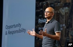 FILE - Microsoft CEO Satya Nadella delivers the keynote address at Build, the company's annual conference for software developers, May 7, 2018, in Seattle.