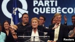 Pemimpin Parti Quebecois, Pauline Marois (tengah) memberikan pidato setelah memenangkan pemilu di negara bagian Quebec (4/9).